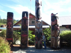 P. Rickrode and totems. Ketchikan, Alaska. Photo by C. Rickrode 2014.