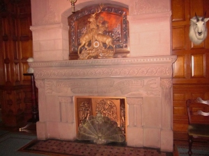 "The main hall fireplace inspribed with this phrase from Shakespear's Troilus and Cressida, ""Welcome ever smiles and farewell goes out sighing."" Craigdarroch Castle, Victoria BC. Photo by P. Rickrode September 2014."