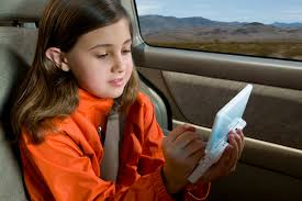 girl-playing-video-game-in-car