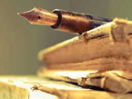 book and quill pen