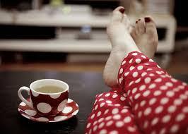 feet on coffee table