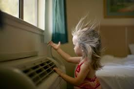 girl in front of AC vent