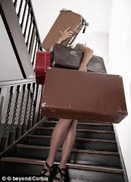 woman carrying lots of suitcases
